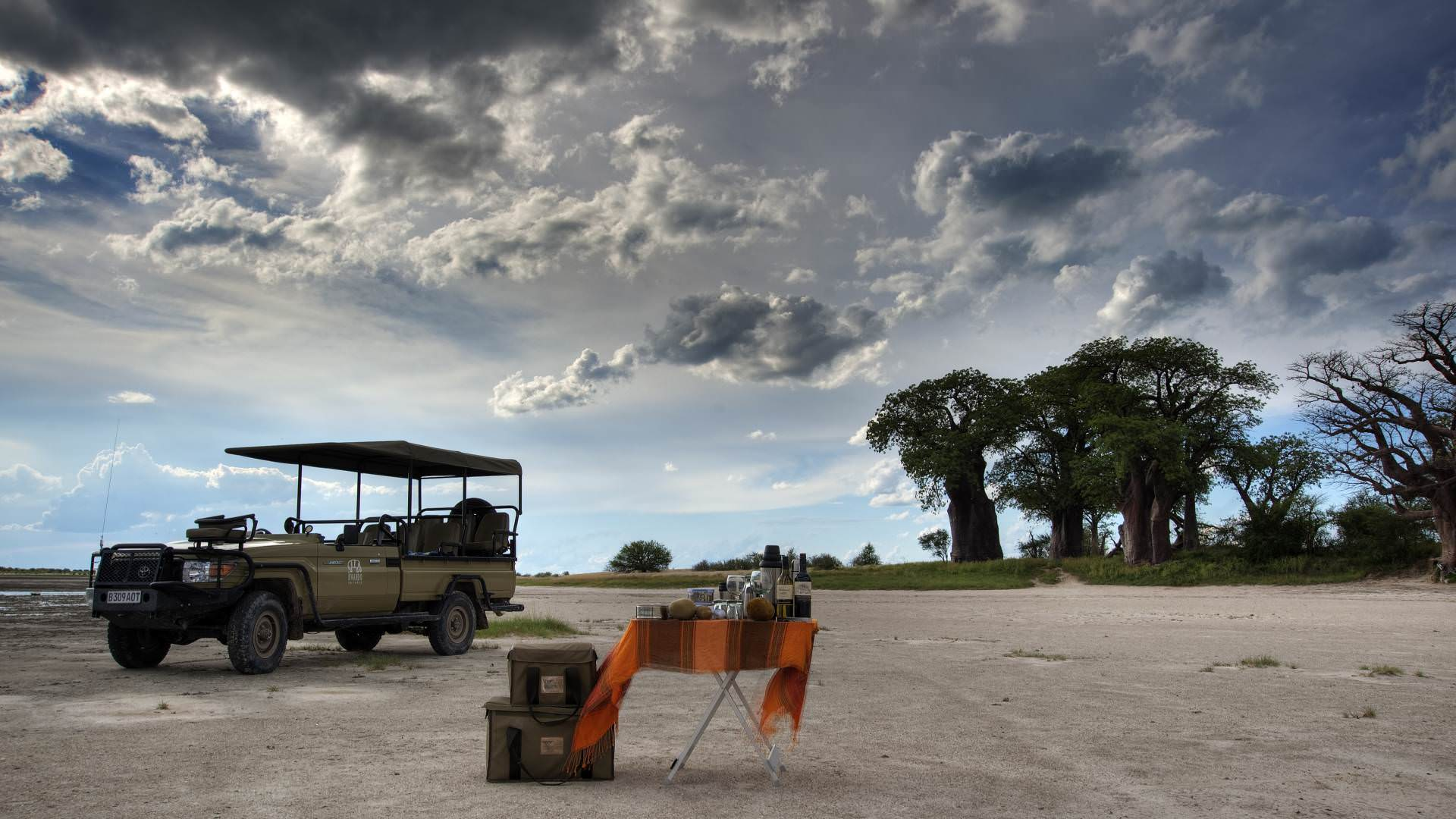 Game drive sundowners with kwando nxai pan camp